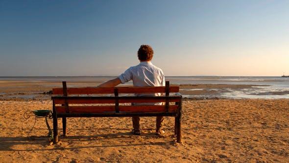 Thumbnail for Man Sitting Alone on  Beach