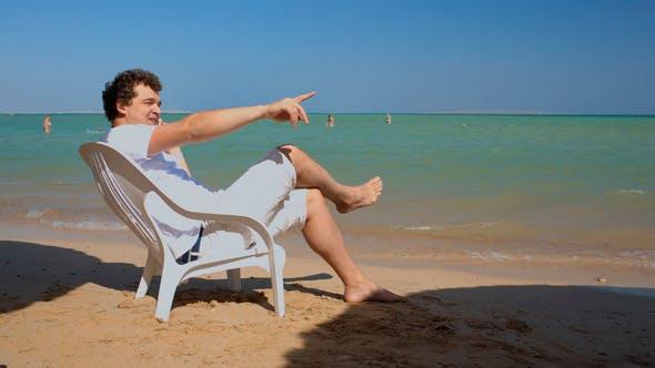 Thumbnail for Phone Talk on  Beach