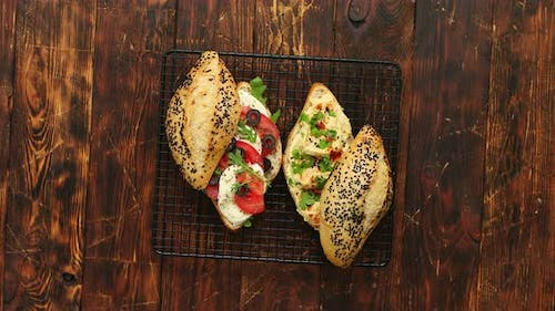Fresh Organic Sandwiches with Hummus and Mozarella Cheese Placed on Black Grill