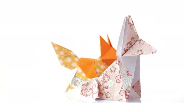 Two Cute Origami Foxes.
