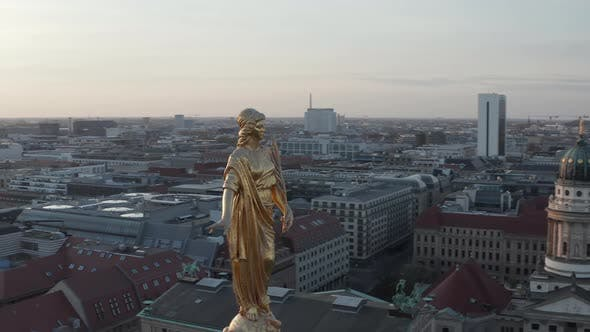 AERIAL: Golden Statue Close Up on Church Cathedral Rooftop in Berlin, Germany, Europe at Dusk