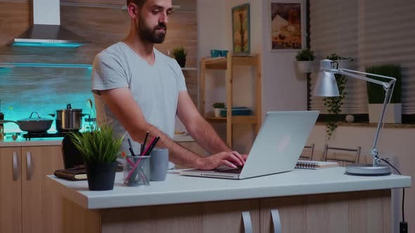 Concentrated Freelance Man Working Overtim