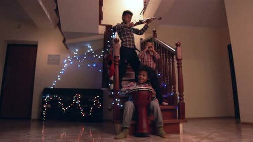 Three Kids Playing Christmas Music.