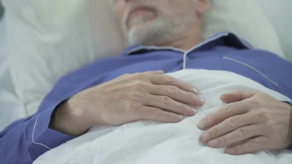 Thumbnail for View of Wrinkled Overworked Hands of Wise Old Man Peacefully Drowsing in Bed