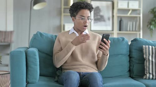African Girl Get Surprised While Scrolling on Phone