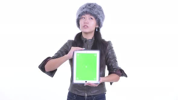 Thumbnail for Happy Beautiful Asian Woman Thinking While Showing Digital Tablet