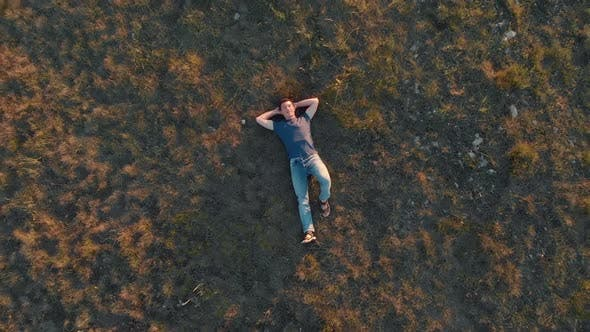 Thumbnail for Aerial Shot Young Man Lying Down and Resting