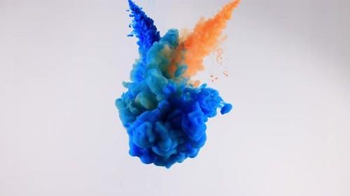 Ink Drops Transition on Blue Background 4k Footage Ink Footage
