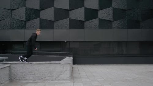 Young Man Does Flip Parkour on Modern City Free Running in Slow Motion