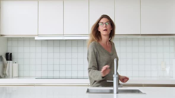 Thumbnail for Woman Dancing in Kitchen