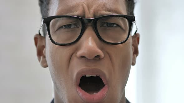 Close Up of Shocked Face of African Businessman, Astonished By Loss