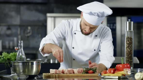 Thumbnail for Male Chef Salting Meat in Slow Motion at Kitchen. Professional Man Cooking Dish