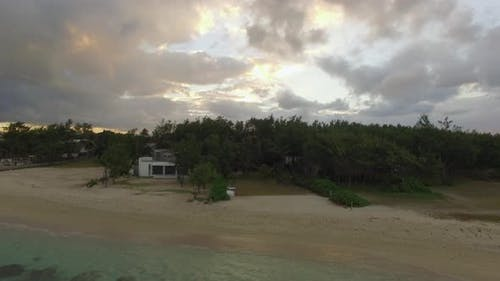 Aerial view of coast from water camera moving to coast, Mauritius Island
