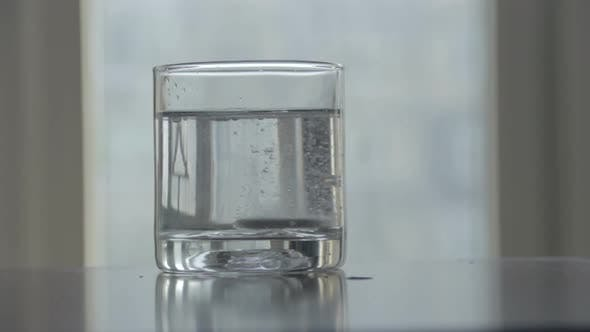 Thumbnail for Dissolving Effervescent Tablet in Clean Glass of Water, Sound