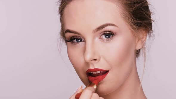 Thumbnail for Female Doing Make-up on Grey Background