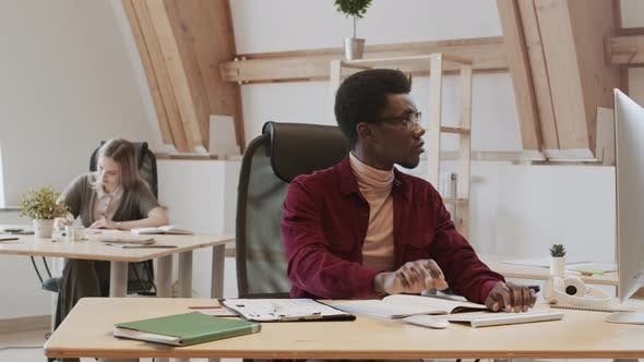 Portrait of Young African Male Designer Working in Office