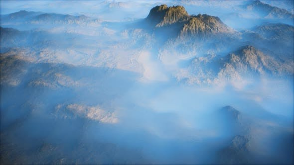 Distant Mountain Range and Thin Layer of Fog on the Valleys