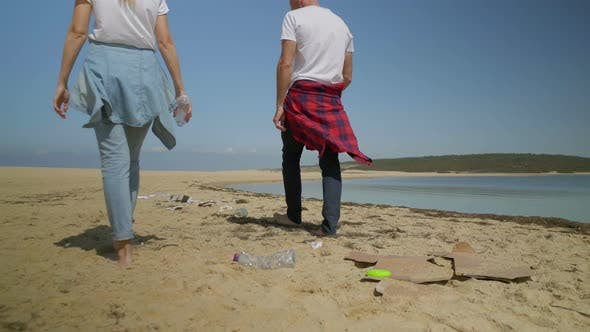 Thumbnail for Couple Walking on Beach Full of Garbage