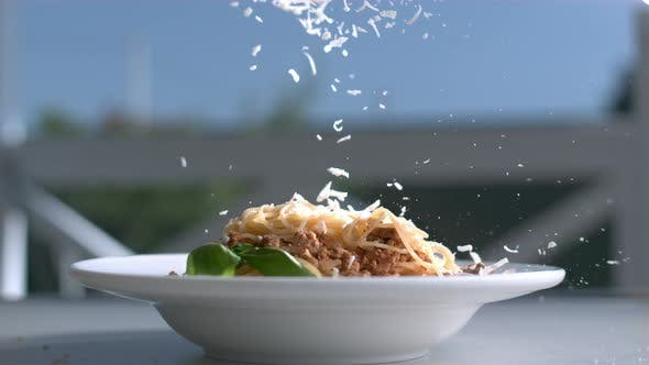 Thumbnail for Pasta With Cheese Plate On A Table And Parmesan Is Falling On Spaghetti In Slow Motion