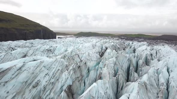 Thumbnail for Low Aerial Forwards Motion Of A Blue Glacier In Island