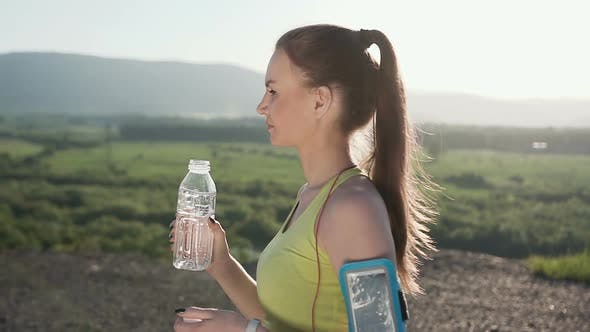 Cover Image for Fitness Young Woman Drinking Water From Sport Bottle