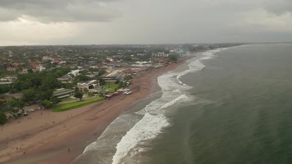 Thumbnail for Aerial View of Famous Tropical Sand Beach and the City of Canggu in Bali During the Rain Season