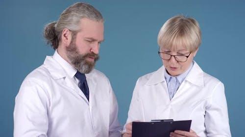 Doctors in White Coats Posing