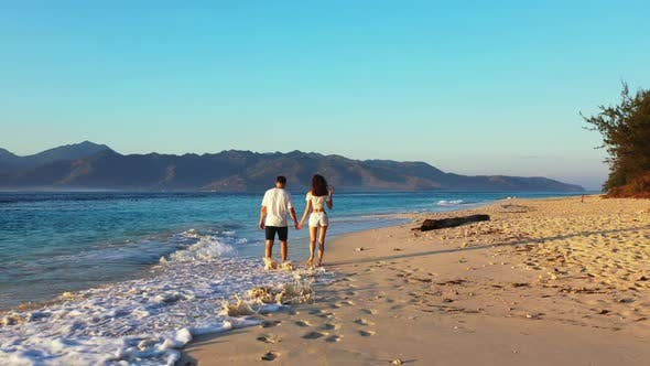 Thumbnail for Teenage lovers tanning on idyllic seashore beach time by transparent ocean and white sand background