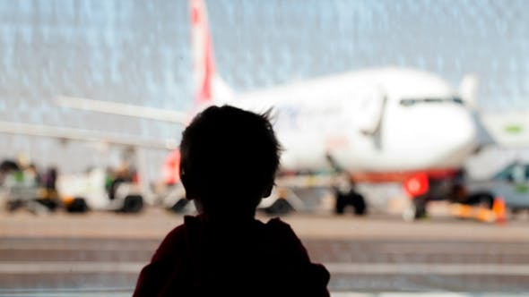 Thumbnail for Little Boy Watching Planes At  Airport