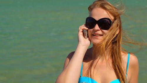 Phone Talk By  Sea