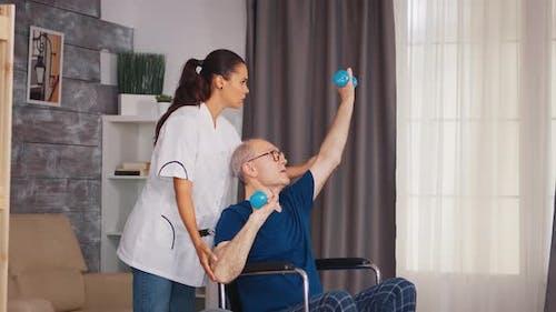 Disabled Senior Man Doing Exercise