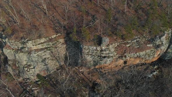 Cover Image for Aerial Of Rock Bluff Cliffs In Woods