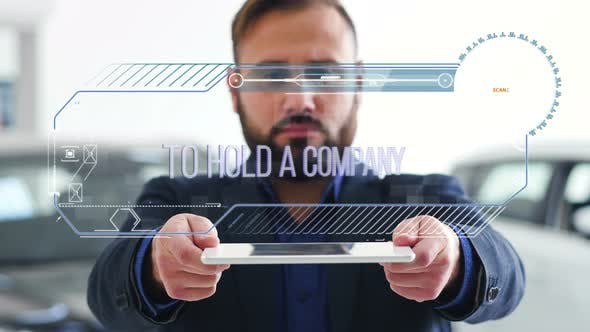 Thumbnail for Businessman Holds a Tablet with HUD Futuristic Elements. Hologram with an Inscription - To Hold a