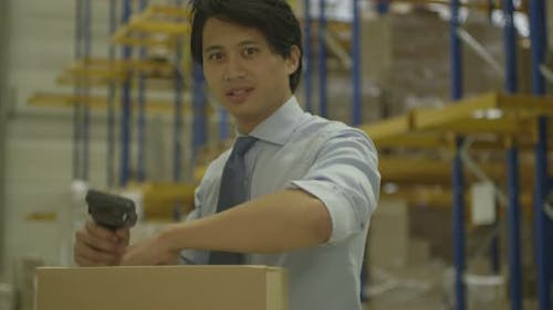 MS TD Man using barcode reader in Logistics warehouse