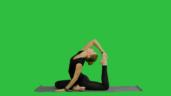 Thumbnail for Young Beautiful Woman Doing Yoga Pose, Stretching Her Body on a Green Screen, Chroma Key