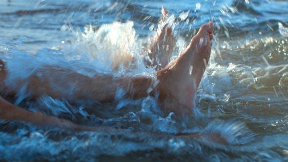 Thumbnail for Splashing Feet in  Sea