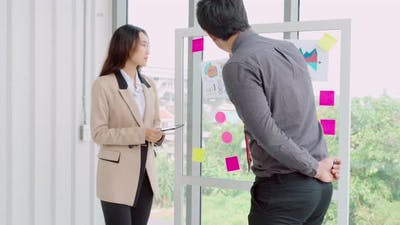 Business People Work on Project Planning Board