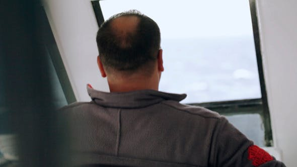 Thumbnail for Man Driving A Yacht