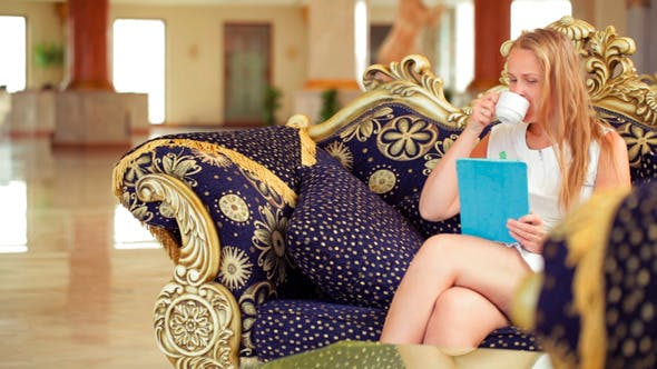 Thumbnail for Beautiful Woman Using Tablet In A Hotel Lobby