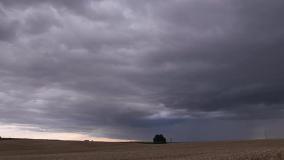 Cloudy Sky Over A Wheat Field