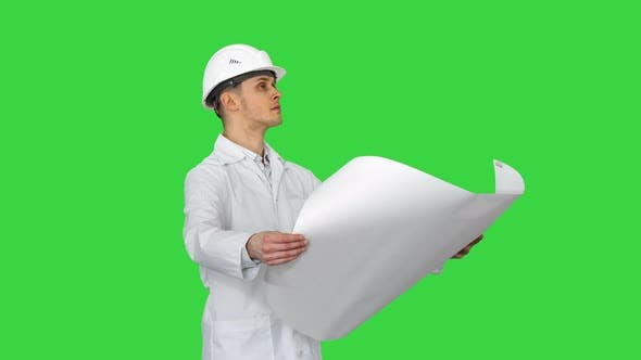 Thumbnail for Handsome Engineer, Architect, Builder, Businessman, Wearing a White Helmet Holding a Project in His