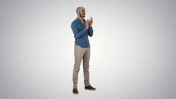 Thumbnail for Handsom arab clapping his hands applauding on gradient background.
