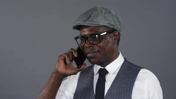 Thumbnail for Fashionable African Man Talking on Phone