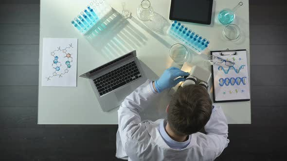 Thumbnail for Laboratory Worker Looking Into Microscope, Disappointed by Experiment Failure
