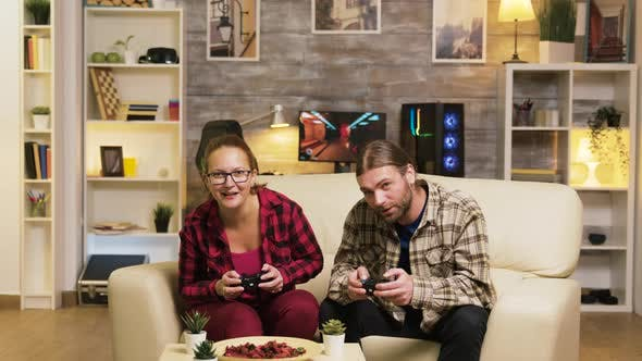 Thumbnail for Couple Celebrating Victory While Playing Video Games