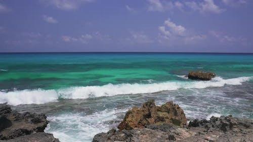 Beautiful Blue Caribbean Sea and Large Waves Float on the Atlantic Ocean