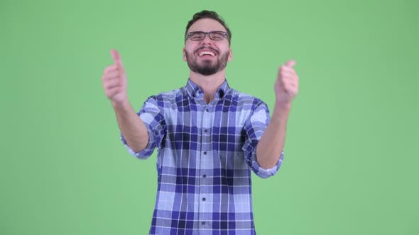 Thumbnail for Happy Young Bearded Hipster Man Giving Thumbs Up and Looking Excited