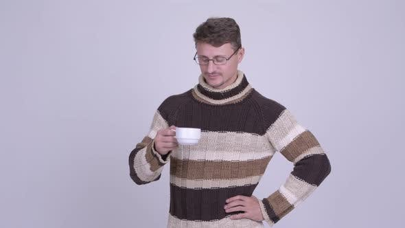 Cover Image for Handsome Bearded Man Thinking While Drinking Coffee