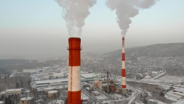 Thumbnail for Industrial Zone with a Large Red and White Pipe Thick White Smoke Is Poured From the Factory Pipe in