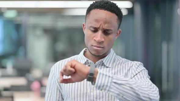 African Businessman Watching Smart Watch Waiting